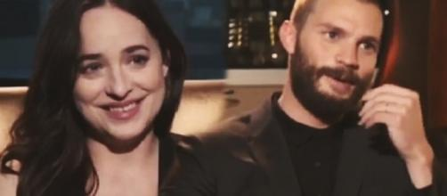 Dakota Johnson, Jamie Dornan - Image via YouTube/The50ShadesWorld.com