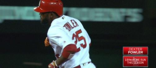 The Cardinals' Dexter Fowler helped his team tie the game late and then win the game over the Reds in the 10th inning. [Image via MLB/YouTube]