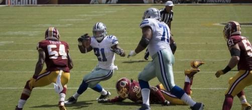 Dallas Cowboys running back Ezekiel Elliott rushing against the Washington Redskins. Image Credit: Keith Allisson, Flickr -- CC BY-SA 2.0