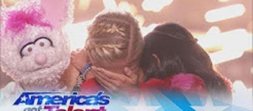 """Darci Lynne shares a tearful hug with Angelica Hale after taking the top vote and the """"America's Got Talent"""" Season 12 title. Screencap AGT/YT"""