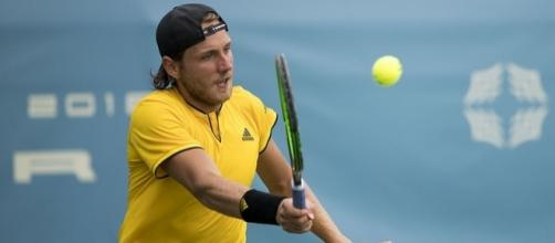 French tennis player Lucas Pouille plays a volley. Image Credit. Keith Allison, Flickr -- CC BY-SA 2.0
