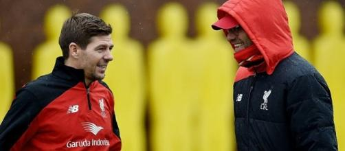 Liverpool manager Jurgen Klopp consulting with Steven Gerard during training in the past. FILE PHOTO// Flickr Football