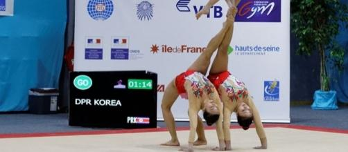 Women gymnasts of North Korea in 2014 Acrobatic Gymnastics World Championships (Credit – Pierre-Yves Beaudouin - Wikimedia Commons)