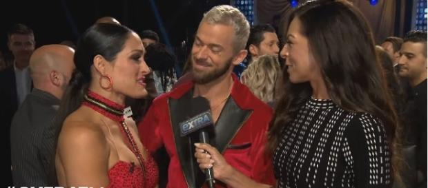 """Nikki Bella with partner Artem Chigvintsev after their performance in """"Dancing With the Stars."""" Photo - extratv/YouTube"""