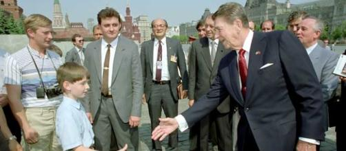 President Reagan greets a young boy while touring Red Square by Fed Govt/Wikimedia Commons