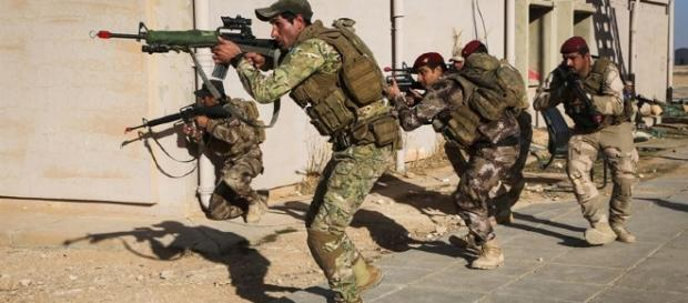 US-trained Iraqi forces prepare for an assault. Image Source;centcom.mil