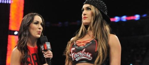 """Brie and Nikki Bella want to make a WWE comeback in 2018 as """"The Bella Twins."""" [Image via WWE/YouTube]"""