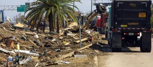 Clearing the debris after a hurricane (Credit - Brooks O. Hubbard IV – Wikimedia Commons)