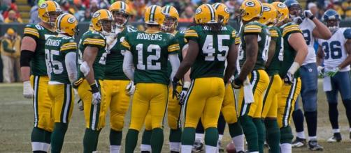 Green Bay Packers huddle. [Image by Mike Morbeck|Wikimedia Commons]