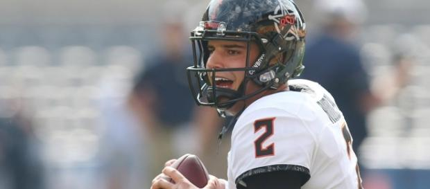 Quarterback Mason Rudolph and the Oklahoma State Cowboys host the TCU Horned Frogs on Saturday. [Image via ACC Digital Network/YouTube]