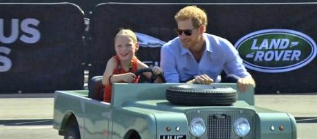 5-year-old Daimy Gommers took Prince Harry for a drive at the Invictus Games. [Image Credit: YouTube/The Telegraph]