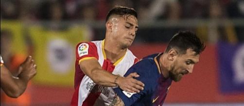 Messi y Maffeo, en un lance del partido de ayer