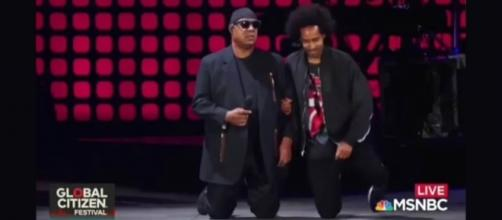 """Stevie Wonder """"took a knee"""" for America at the Global Citizen Festival [Image: YouTube/Supreme video]"""
