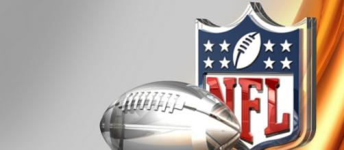 Silver Football and NFL Logo Over Bronze Silk Background- Image by C_osett \ CCo Public Domain | Flickr