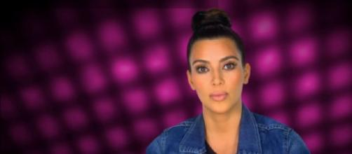 Kim Kardashian's surrogate had a health scare. [Image via E!/YouTube screengrab]