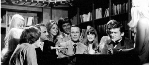 Photo of Don Adams (center) Barbi Benton and Hugh Hefner from the television program Playboy After Dark - Image CCo Public Domain | Wikimedia