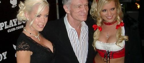 'Playboy' founder, Hugh Hefner (middle), with the girls [Credit: Alexander Hauk via Wikimedia Commons]