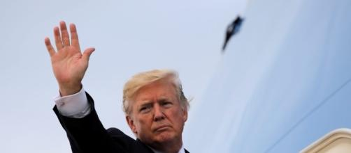 Trump turns focus on Puerto Rico, promising aid and a visit