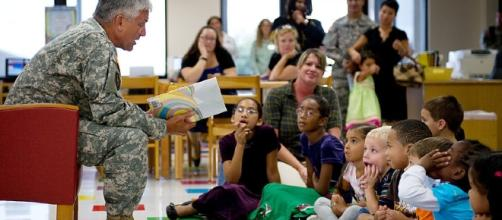 Chief of Staff of the Army Gen. George W. Casey read Dr. Seuss to children. (Image Credit: US Army / Wikimedia commons)