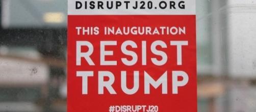 DisruptJ20 sticker at Donald Trump's inauguration ceremony. [Image Credit: Elvert Barnes/Flickr]