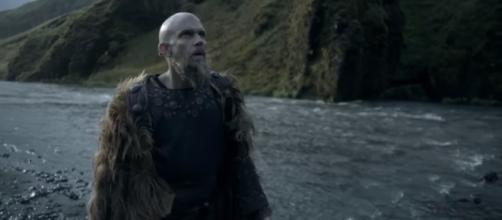 Floki marvels at a waterfalls in Iceland and sees something surprising. [Image Credit: YouTube/History]