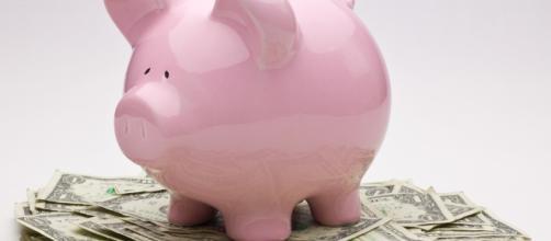 Piggy bank and paper bills | photo via Ken Teegardin, Flickr