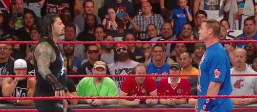 Roman Reigns and John Cena are tied atop the odds list for who might win the 'Royal Rumble' match next year. [Image via WWE/YouTube]