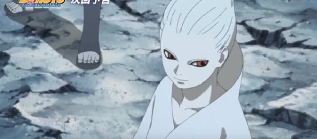 Sakura and Sasuke surprise Sarada with their perfectly coordinated attacks. [Image via YouTube/Dark Aces]