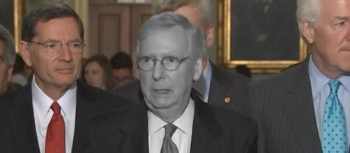 A greyed out Mitch McConnell. [Image Credit: PBS Newshour/YouTube)