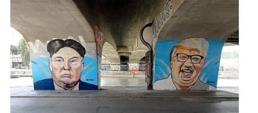 Graffiti of US Donald Trump and Kim Jong-un photo by Bwag | Wikimedia