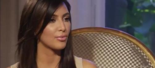Kim Kardashian finally confirms third baby. (Image Credit- E! Online Youtube screengrab)
