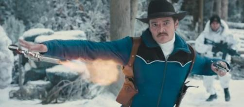 "Pedro Pascal as ""Whiskey,"" shooting pistols in the new ""Kingsman"" film. (Image Credit: 20th Century Fox/Youtube)"