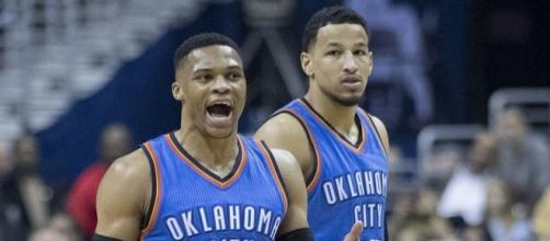 Russell Westbrook signs the extension with OKC. (Photo Credit: Keith Allison/Wikimedia Commons)