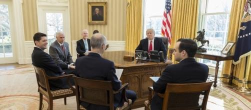 Tom Price and others sitting with President Trump in Oval Office. / [Image by The White House via Flickr, Public Domain]