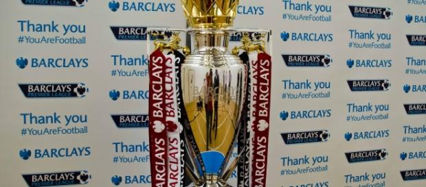The Barclays Premier League trophy with the Manchester United ribbons on it. PHOTO/ Flickr