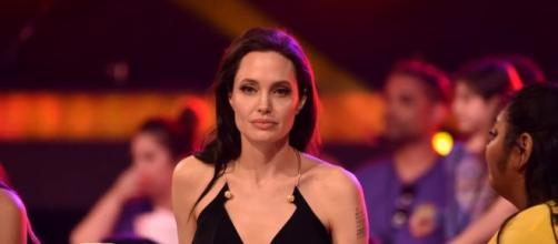 Angelina Jolie said that single life is not easy for her. [Image via YouTube/Entertainment Tonight]