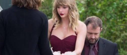 Taylor Swift attended best friend's wedding in burgundy maxi dress. YouTube/nICE TUBE