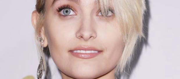 Paris Jackson poses nude as she flaunted her newest chakra tattoo symbol on her chest. YouTube/Hollyscoop