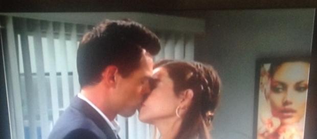 Billy and Victoria kiss. Screen shot Cheryl E Preston.