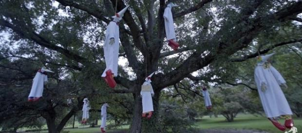 Art activist collective INDECLINE hung clown effigies dressed in Ku Klux Klan costumes in Bryan Park [Image: YouTube/INDECLINE]