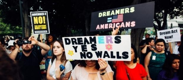 Immigration advocates for DREAMers. [Image via Flickr/Molly Adams]