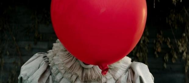 A teenager confessed to placing red balloons around town, leading to police's viral Facebook post [Image: YouTube/Warner Bros. Pictures]