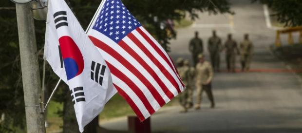 A U.S. and South Korean flag ly next to each other at Yongin, South Korea. Photo: Staff Sgt. Ken Scar/Creative Commons