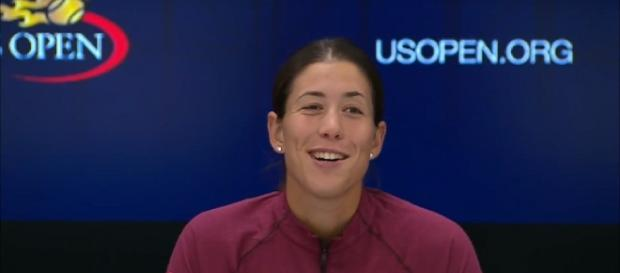 Garbine Muguruza at a press conference at 2017 US Open. [Image via YouTube/US Open Tennis Championships]