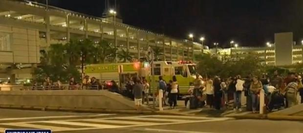 Man with knife shot at Miami-Dade International Airport as people evacuated for Irma [Image: YouTube/CBS Miami]