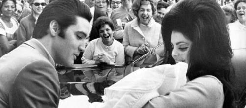Elvis, Priscilla and Lisa Marie Presley, happy times long ago. Photo credit: Wikimedia