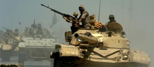 Iraqi T-72 tanks pass through a checkpoint in Mushahada, Iraq | Photo from Michael Larson via Wikipedia Commons.