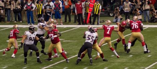 San Francisco 49ers quarterback Colin Kaepernick attempts a pass in Super Bowl XLVII. Photo by Au Kirk, courtesy of Flickr.com