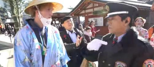 Logan Paul with the Japanese police. [Image via YouTube.com/LoganPaulVlogs]