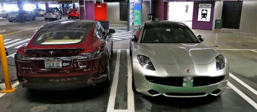 Tesla Model S electric car (left) and Fisker Karma plug-in hybrid. - [Image credit - Steve Jurvetson / Wikimedia Commons]